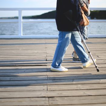 woman walking jeans pier